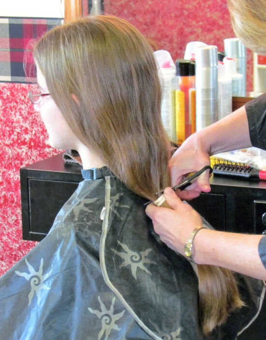 Local girl donates hair to Locks of Love for third time