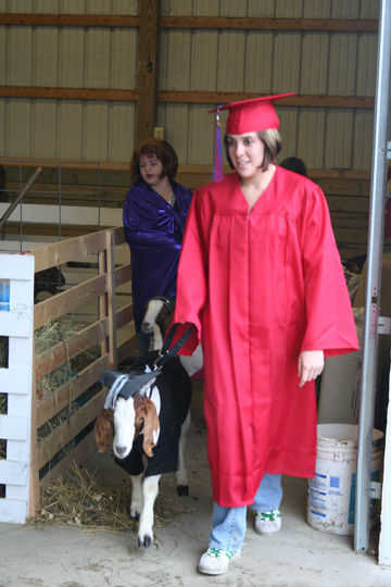 Recent South Putnam graduate Tabitha Arnold puts her cap and gown to  creative use along with her goat Butterfinger. cdbbdf6abe1